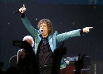 Mick Jagger of the Rolling Stones performs during their 14 on Fire concert at Marina Bay Sands in Singapore in this March 15, 2014 file photo. REUTERS/Tim Chong/Files