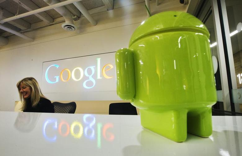 A Google Android figurine sits on the welcome desk as employee Tracy McNeilly smiles at the new Google office in Toronto, November 13, 2012. REUTERS/Mark Blinch/Files