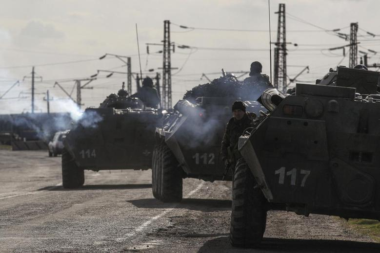 Putin signs Crimea treaty as Ukraine serviceman dies...