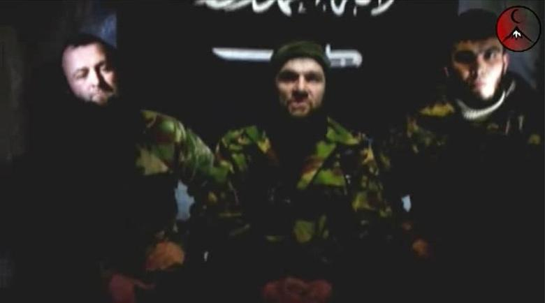 An undated still image taken from video shows the address of Chechen rebels, led by Emir of the Caucasus Doku Umarov (C). REUTERS/www.kavkazcenter.com/Reuters TV
