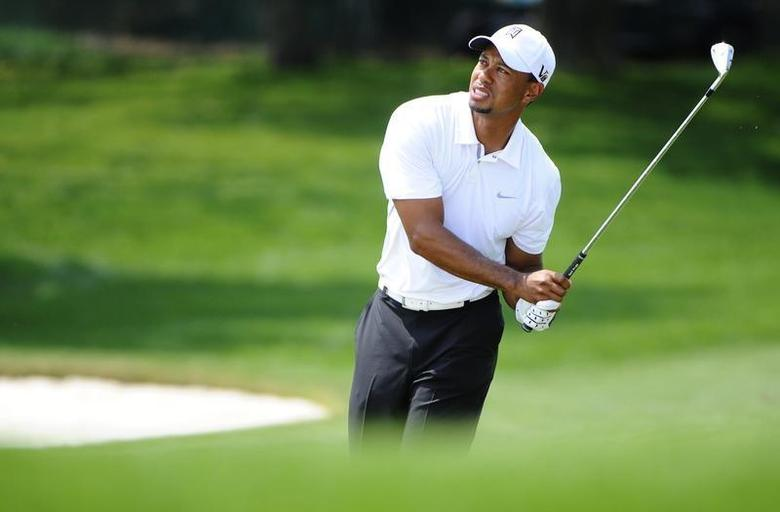 Tiger Woods of the U.S. reacts to his shot on the fifth hole during third round play in the Arnold Palmer Invitational PGA golf tournament in Orlando, Florida March 23, 2013. REUTERS/Brian Blanco