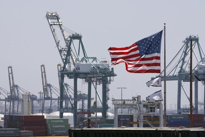 A U.S. flag flies at the Port of Los Angeles in Los Angeles, California, May 30, 2012. REUTERS/David McNew