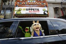 """The characters of Kermit and Miss Piggy arrive at the premiere of """"Muppets Most Wanted"""" in Hollywood, California in this file photo taken March 11, 2014. REUTERS/Mario Anzuoni/Files"""