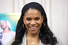 "Actress Audra McDonald poses for a photograph while promoting the play ""Lady Day at Emerson's Bar and Grill"" in New York March 17, 2014. REUTERS/Lucas Jackson"