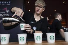 Sandy Roberts pours samples of Starbucks Reserve Sun Dried Ethiopia Yirgacheffe coffee during the company's annual shareholders meeting in Seattle, Washington March 19, 2014. REUTERS/David Ryder