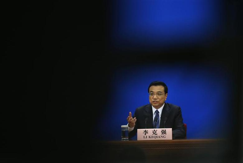 A picture taken through tripod shows China's Premier Li Keqiang during a news conference, after the closing ceremony of the Chinese National People's Congress (NPC) at the Great Hall of the People, in Beijing, March 13, 2014 file photo. REUTERS/Kim Kyung-Hoon
