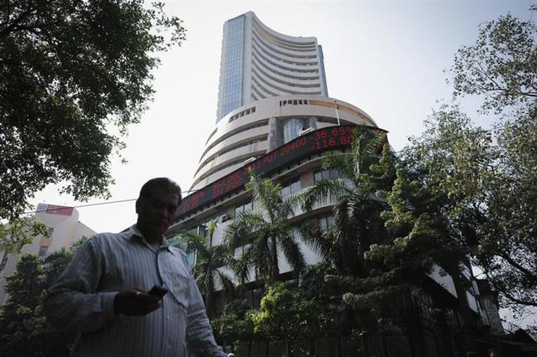 A man walks past the Bombay Stock Exchange (BSE) building in Mumbai December 5, 2013. REUTERS/Danish Siddiqui/Files