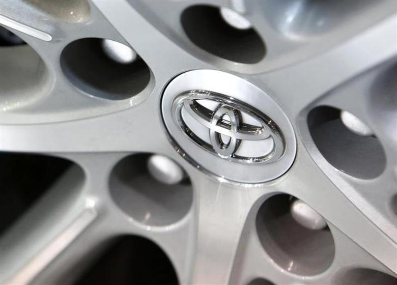 A Toyota Motor Corp logo is pictured on the wheel of a car at its showroom in Tokyo February 4, 2014. REUTERS/Yuya Shino/files