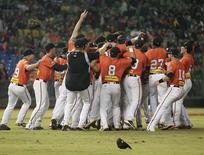 Australia's Canberra Cavalry players celebrate after defeating Taiwan's Uni-President 7-Eleven Lions 14-4 during their Asia Series 2013 baseball game final at Taichung Intercontinental Baseball Stadium November 20, 2013. REUTERS/Pichi Chuang