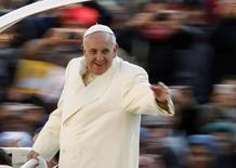 Pope Francis waves as he arrives to conduct his weekly general audience at St. Peter's Square at the Vatican December 11, 2013. REUTERS/Giampiero Sposito