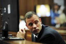 Olympic and Paralympic track star Oscar Pistorius sits in the dock during court proceedings at the North Gauteng High Court in Pretoria March 19, 2014. REUTERS/Leon Sadiki/Pool