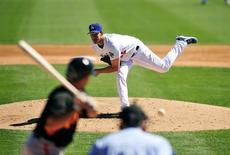 Mar 9, 2014; Glendale, AZ, USA; Los Angeles Dodgers starting pitcher Clayton Kershaw (22) pitches the third inning against the San Francisco Giants at Camelback Ranch. Gary A. Vasquez-USA TODAY Sports