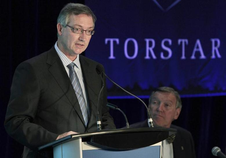 Torstar Corp President and Chief Executive Officer David Holland speaks as Chair of the Board John Honderich looks on at the annual general meeting for shareholders in Toronto, May 5, 2010. REUTERS/Mark Blinch