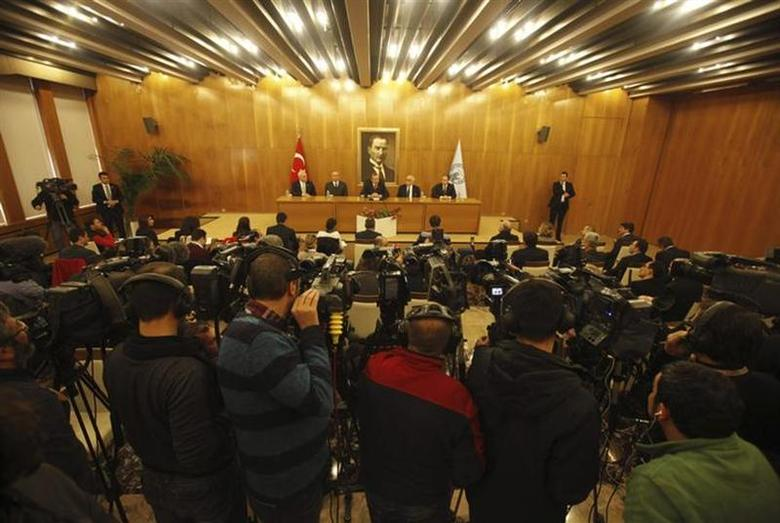 Cameramen film a news conference by Turkey's Prime Minister Tayyip Erdogan in Istanbul February 3, 2014. REUTERS/Osman Orsal/Files