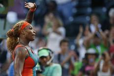 Mar 20, 2014; Miami, FL, USA; Serena Williams waves to the crowd after her match against Yaroslava Shvedova (not pictured) on day four of the Sony Open at Crandon Tennis Center. Williams won 7-6, 6-2. Mandatory Credit: Geoff Burke-USA TODAY Sports - RTR3HYRF