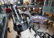 People shop in the Eaton Centre shopping mall as they walk by a giant reindeer Christmas decoration in Toronto, December 7, 2012. REUTERS/Mark Blinch