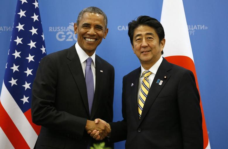 U.S. President Barack Obama (L) shakes hands with Japanese Prime Minister Shinzo Abe at the G20 Summit in St. Petersburg, Russia September 5, 2013. REUTERS/Kevin Lamarque