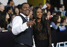 """Cast member Mekhi Phifer and his wife Reshelet Barnes pose at the premiere of """"Divergent"""" in Los Angeles, California March 18, 2014. REUTERS/Mario Anzuoni"""