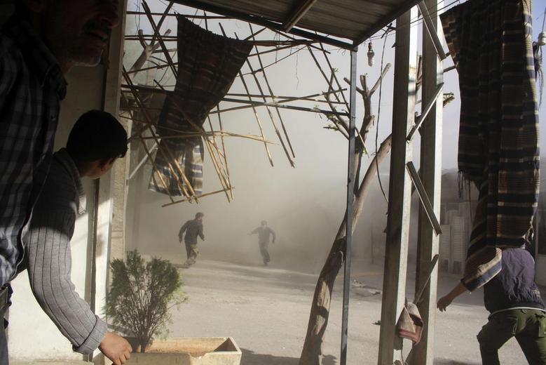 Rebels battle for Syria border post near Mediterranean