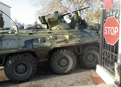 Shots fired as Russian troops force their way into Ukrainian base in Crimea