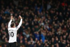 Manchester United's Wayne Rooney celebrates after scoring a goal against West Ham United during their English Premier League soccer match at the Boleyn Ground in London March 22, 2014. REUTERS/Andrew Winning