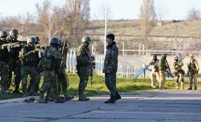 Russian troops seize Crimea airbase as Moscow consolidates control