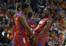 Mar 22, 2014; Buffalo, NY, USA; Dayton Flyers forward Dyshawn Pierre (21) and Dayton Flyers forward Kendall Pollard (22) celebrate beating the Syracuse Orange after a men's college basketball game during the third round of the 2014 NCAA Tournament at First Niagara Center. Timothy T. Ludwig-USA TODAY Sports