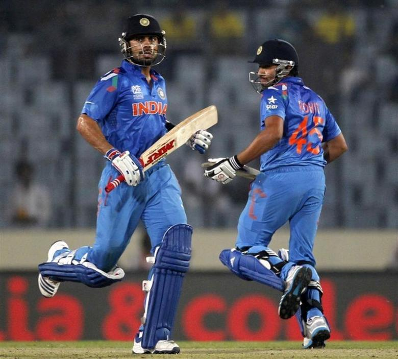 India's Virat Kohli and Rohit Sharma (R) run between the wickets against West Indies during their ICC Twenty20 World Cup match at the Sher-E-Bangla National Cricket Stadium in Dhaka March 23, 2014. REUTERS/Andrew Biraj