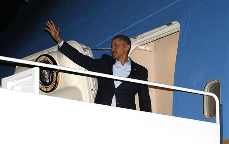 U.S. President Barack Obama departs Joint Base Andrews in Washington March 23, 2014. REUTERS/Kevin Lamarque