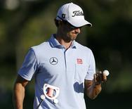 Adam Scott of Australia looks at his ball as he walks off the 13th green during the first round at the Sony Open golf tournament at Waialae Country Club in Honolulu, Hawaii, January 9, 2014. REUTERS/Hugh Gentry