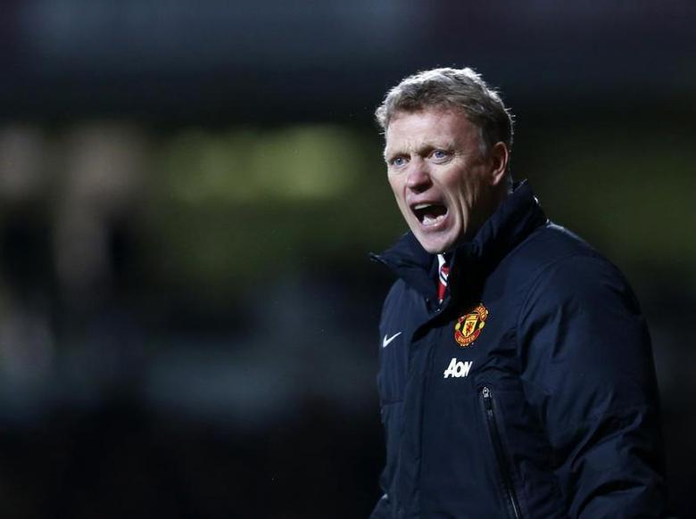 Manchester United manager David Moyes reacts during their English Premier League soccer match against West Ham United at the Boleyn Ground in London March 22, 2014. REUTERS/Andrew Winning