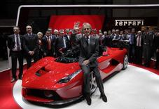 Ferrari CEO Luca Cordero di Montezemolo waves to the media after the presentation of the new LaFerrari hybrid car on the Ferrari stand during the first media day of the 83rd Geneva Car Show at the Palexpo Arena in Geneva March 5, 2013. REUTERS/Denis Balibouse