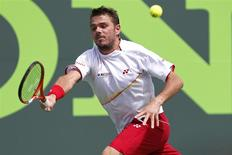 Stanislas Wawrinka hits a forehand against Daniel Gimeno-Traver (not pictured) on day six of the Sony Open at Crandon Tennis Center. Mandatory Credit: Geoff Burke-USA TODAY Sports