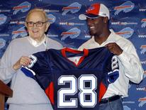Buffalo Bills owner Ralph Wilson (L) appears during a news conference with Bills NFL first round draft pick Leodis McKelvin, a defensive back from Troy University, at the Bills' fieldhouse in Orchard Park, New York, in this April 27, 2008, file photo. Wiepert/Files