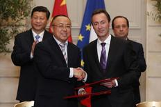 Fabrice Bregier (R), Airbus President and Chief Executive Officer, and Li Hai, President of CASC shake hands at a signing ceremony at the Elysee Palace in Paris March 26, 2014. REUTERS/Benoit Tessier