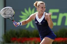 Mar 26, 2014; Miami, FL, USA; Dominika Cibulkova celebrates after her match against Agnieszka Radwanska (not pictured) on day ten of the Sony Open at Crandon Tennis Center. Cibulkova won 3-6, 7-6, 6-3. Geoff Burke-USA TODAY Sports