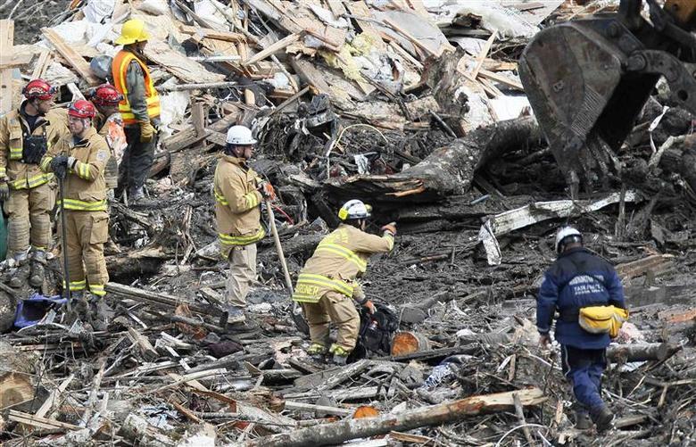 Washington mudslide yields more bodies, but not all...
