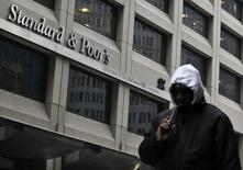 A man walks past the Standard & Poor's building in New York's financial district February 5, 2013. REUTERS/Brendan McDermid