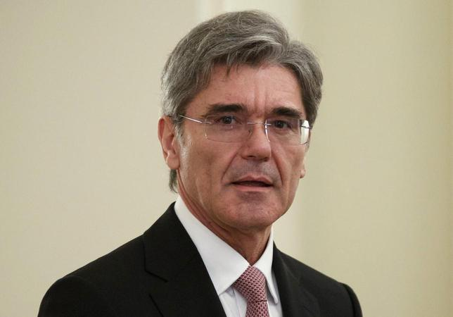 CEO of the Siemens AG Joe Kaeser waits before meeting Russian President Vladimir Putin at the Novo-Ogaryovo state residence outside Moscow, March 26, 2014. REUTERS/Alexander Zemlianichenko/Pool