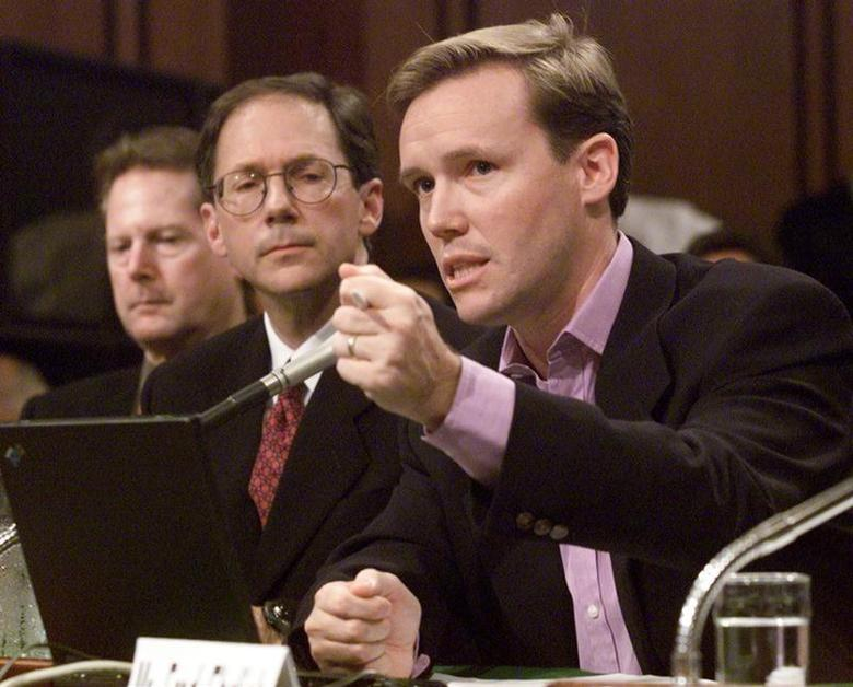 Michael Robertson (R), CEO of MP3.com, testifies before a Senate Judiciary committee on Capital Hill on the future of digital music, July 11, while Hank Barry (C), CEO of Napster Inc. and Roger McGuinn, member and co-founder of the band The Byrds, listen. MMR/RCS
