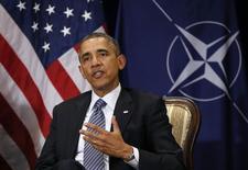 Президент США Барак Обама во время встречи с генсеком НАТО в Брюсселе 26 марта 2014 года. НАТО необходимо постоянное присутствие в тех странах Восточной Европы, которые чувствуют себя уязвимыми после аннексии Россией украинского Крыма, сказал президент США Барак Обама, выразив озабоченность сокращением расходов на оборону рядом европейских стран. REUTERS/Kevin Lamarque