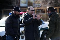 "Director Scott Winant (C) directs his crew during a scene on the set of the new ""Fargo"" TV series in Calgary, Alberta, March 11, 2014. REUTERS/Todd Korol"