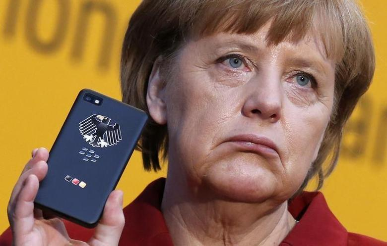 German Chancellor Angela Merkel holds a BlackBerry Z10 smartphone featuring high security Secusite software, used for governmental communication, at the booth of Secusmart during her opening tour at the CeBit computer fair in Hanover March, 5, 2013. REUTERS/Fabrizio Bensch