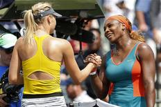 Mar 27, 2014; Miami, FL, USA; Serena Williams (right) shakes hands with Maria Sharapova (left) after their match on day eleven of the Sony Open at Crandon Tennis Center. Wiliams won 6-4, 6-3. Geoff Burke-USA TODAY Sports