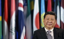 Chinese President Xi Jinping looks on during a visit at the UNESCO headquarters in Paris, March 27, 2014. REUTERS/Christian Hartmann