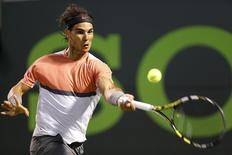 Mar 27, 2014; Miami, FL, USA; Rafael Nadal hits a forehand against Milos Raonic (not pictured) on day eleven of the Sony Open at Crandon Tennis Center. Geoff Burke-USA TODAY Sports