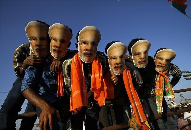 Supporters of Gujarat's chief minister Narendra Modi, the prime ministerial candidate for the Bharatiya Janata Party (BJP), wear masks of Modi during a rally being addressed by Modi ahead of the 2014 general elections, in Chennai February 8, 2014. REUTERS/Babu/Files