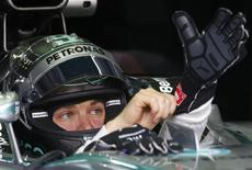 Mercedes Formula One driver Nico Rosberg of Germany wears a glove as he sits in his car during the second practice session of the Malaysian F1 Grand Prix at Sepang International Circuit outside Kuala Lumpur, March 28, 2014. REUTERS/Edgar Su
