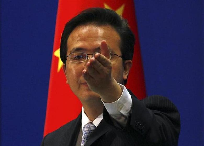 China's Foreign Ministry spokesman Hong Lei asks journalists for questions during a news conference in Beijing July 7, 2011. REUTERS/David Gray/Files