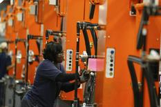 A BMW employee works on the door assembly for the X4 at the BMW manufacturing plant in Spartanburg, South Carolina March 28, 2014. REUTERS/Chris Keane